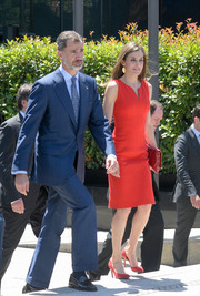 Queen Letizia of Spain attended the La Caixa Scholarships event wearing a simple red dress by Hugo Boss.