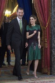 Queen Letizia of Spain kept it classy and ladylike in a green and purple floral frock by Carolina Herrera during a reception for Costa Rica's President.