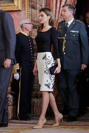 Princess Letizia opted for simple nude patent pumps to complete her outfit.