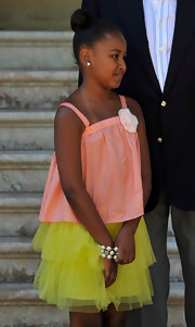 Sasha Obama wore a darling tulle skirt with a coral tank top while meeting the Spanish Royals with her parents.