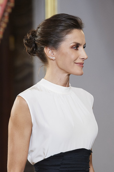 Queen Letizia of Spain styled her hair into an elegant twisted bun for a reception for COP25 participants at the Royal Palace.