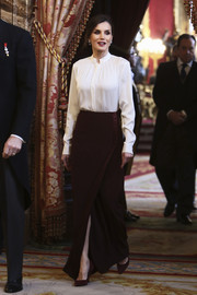 Queen Letizia of Spain kept it classic in a long-sleeve white blouse by Hugo Boss while receiving the Diplomatic Corps at Zarzuela Palace.