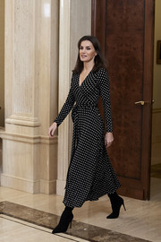 Queen Letizia of Spain looked effortlessly chic in a black-and-white polka-dot wrap dress by Carolina Herrera while receiving the National Handball Men's Team at Zarzuela Palace.