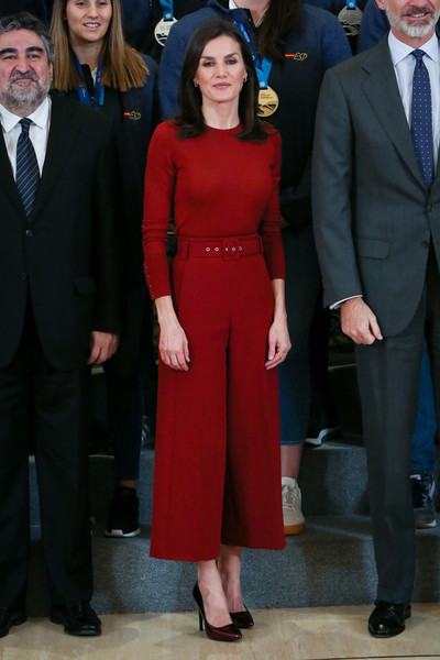 Queen Letizia of Spain kept it simple in a red crewneck sweater by Hugo Boss while receiving the National Water Polo Team at Zarzuela Palace.