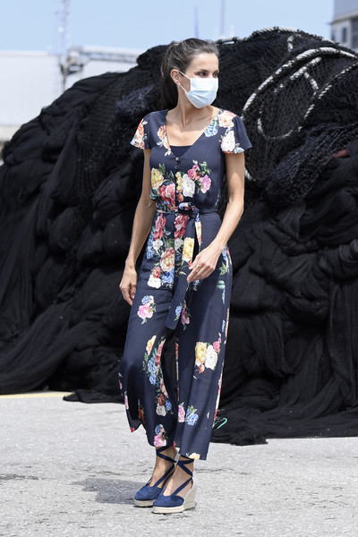 Queen Letizia of Spain teamed a pair of navy espadrille wedges by Calzados Picon with a floral jumpsuit for her tour of Cantabria.