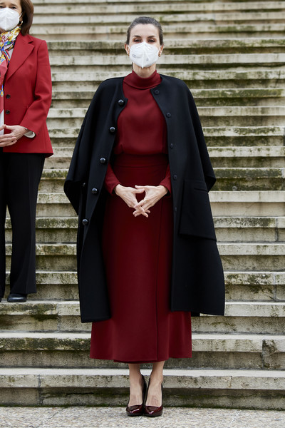 Queen Letizia of Spain layered a high-neck red dress under a black cape for the 'Concepcion Arenal. La Pasion Humanista 1820-1893' exhibition.