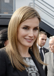 Princess Letizia was sleekly styled with this trendy layered 'do during her visit to the Getty House.