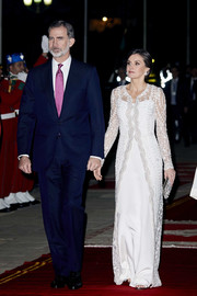 Queen Letizia of Spain was the picture of elegance in a white column dress with an embroidered overlay while attending a gala dinner at the Royal Palace in Morocco.