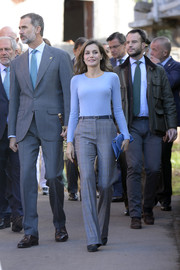 Queen Letizia of Spain stayed relaxed yet stylish in a cornflower-blue crewneck sweater by Hugo Boss while visiting Porenu village.