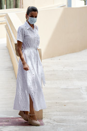 Queen Letizia of Spain was summer-chic in a white eyelet shirtdress while visiting a socio-educational center in Mallorca.