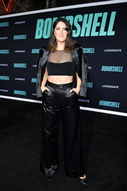 D'Arcy Carden hit the special screening of 'Bombshell' wearing a black satin pantsuit by Azzi & Osta.