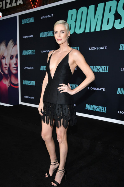 Charlize Theron looked ravishing in a Dior Couture LBD with a plunging neckline and a fringed hem at the special screening of 'Bombshell.'