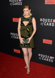 Kate Mara continued the olive-green theme with a simple satin clutch.