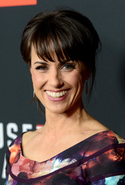 Constance Zimmer pulled her hair back into a simple updo with wispy bangs for the 'House of Cards' season 2 premiere.