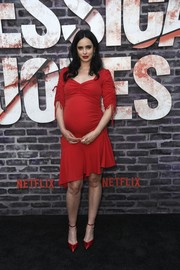 Krysten Ritter matched her dress with a pair of red ankle-strap pumps by Stella Luna.