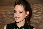 Kristen dressed down a lacy collared top with her signature messy ponytail.