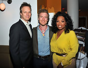 Oprah Winfrey brought a bright splash of color to the 'Odd Life of Timothy Green' screening with her yellow silk blouse.