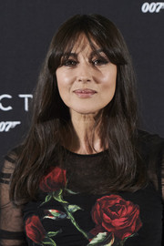Monica Bellucci wore her hair down with barely-there waves and eye-grazing bangs during the 'Spectre' photocall in Madrid.