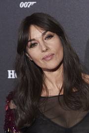Monica Bellucci wore her hair in loose waves with center-parted bangs during the Madrid premiere of 'Spectre.'
