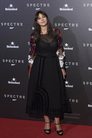 Monica Bellucci kept it ladylike at the Madrid premiere of 'Spectre' in a black cocktail dress adorned with colorful fringed flowers.