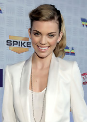 AnnaLynne added a nice touch to her winter white suit with a sleek ponytail.