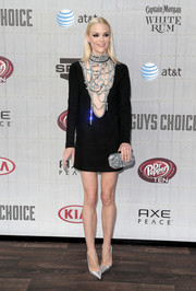 Jaime King completed her glittery ensemble with a silver Edie Parker Fiona clutch.