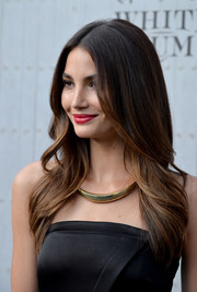 Lily Aldridge complemented her strapless dress with a thick gold necklace.