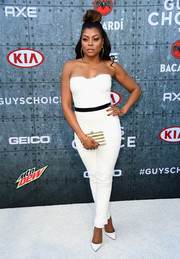 Taraji P. Henson broke her white motif with a striped box clutch by Edie Parker.