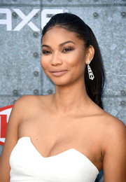 Chanel Iman glammed it up with a pair of diamond chandelier earrings.