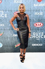Mary J. Blige completed her vampy look with strappy black platform sandals.