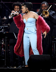 Andra Day layered a wine-colored fur coat over her jumpsuit for added glamour.
