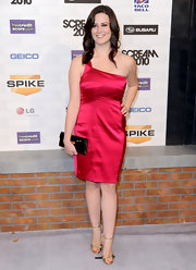 Katie showed off her glamorous side in a one-shoulder satin dress. The hot pink color was the perfect match for her gold sandals.