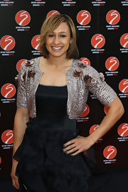 Jessica Ennis dressed up her LBD with a gold sequined bolero at the Sport Industry Awards.