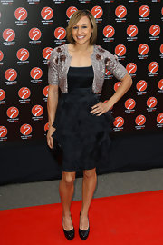 Jessica Ennis went for an ultra-feminine silhouette with this ruffled LBD and sequined bolero at the Sport Industry Awards.