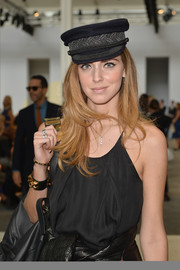 Chiara Ferragni went for cool styling with this black captain's cap at the Sportmax Spring 2014 show.