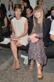 Cindi Leive wore a pair of nude gladiator heels with a little white dress when she attended the Sportmax fashion show.