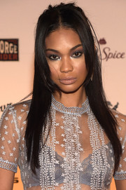 Chanel Iman finished off her beauty look with a glossy nude lip.