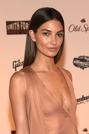 Lily Aldridge wore her hair loose and straight with her signature center part during the SI Swimsuit Takes Over the Schermerhorn Symphony Center event.