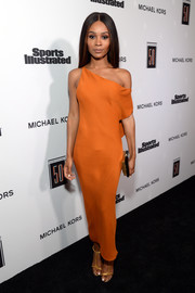 Zuri Hall was sultry and sophisticated in an orange off-one-shoulder dress at the Sports Illustrated 2017 Fashionable 50 celebration.