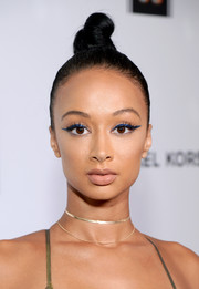 Draya Michele punched up her beauty look with a metallic-blue cat eye.