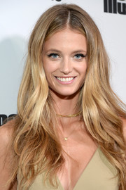 Kate Bock went boho with this long center-parted hairstyle at the Sports Illustrated 2017 Fashionable 50 celebration.