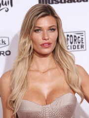Samantha Hoopes styled her long tresses with just a hint of a wave for the Sports Illustrated Swimsuit 2016 celebration.