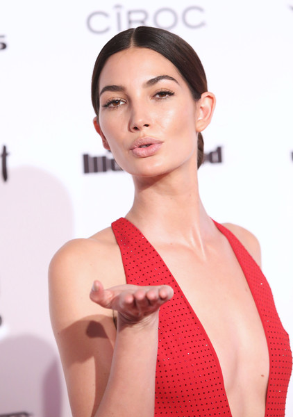 Lily Aldridge opted for a simple center-parted chignon when she attended the Sports Illustrated Swimsuit 2016 celebration.