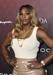 Serena Williams matched her necklaces with a gold cuff bracelet.