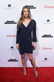 Nina Agdal cut a stylish figure in an embellished navy shift dress by Chanel at the SI Fashionable 50 NYC event.