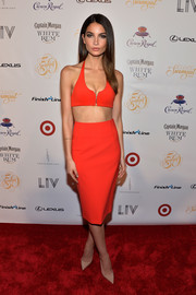Lily Aldridge completed her sexy outfit with a red pencil skirt.