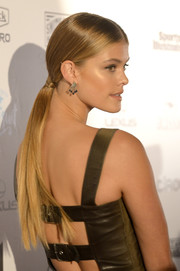 Nina Agdal attended the Sports Illustrated Swim BBQ wearing an elegant low ponytail.