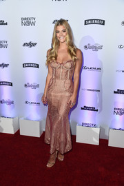 Nina Agdal sheathed her fabulous figure in a pink corset dress by Lana Mueller for the Sports Illustrated Swimsuit 2017 NYC launch.
