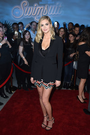Kate Upton teamed a fitted tux jacket with a plunging mini dress, both by Versace, for the Sports Illustrated Swimsuit 2017 NYC launch.