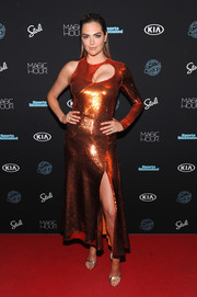 Kate Upton brought a high dose of shimmer to the Sports Illustrated Swimsuit 2018 launch with this metallic one-sleeve cutout dress by Emilio Pucci.